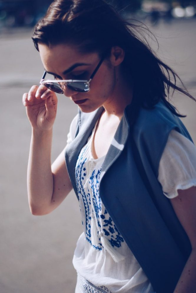 White outfit, white embroidered shirt, so real sunglasses, grey vest by Andreea Birsan