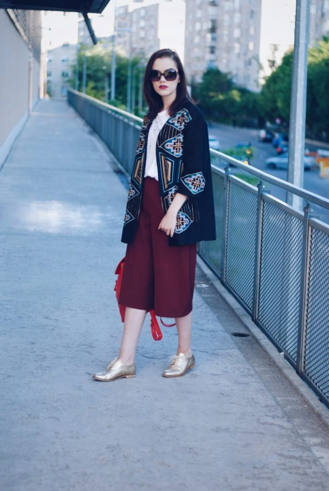 Burgundy culottes, white tshirt, embellished jacket, polaroid sunglasses, gold metallic shoes, red backpack, spring outfit by Andreea Birsan