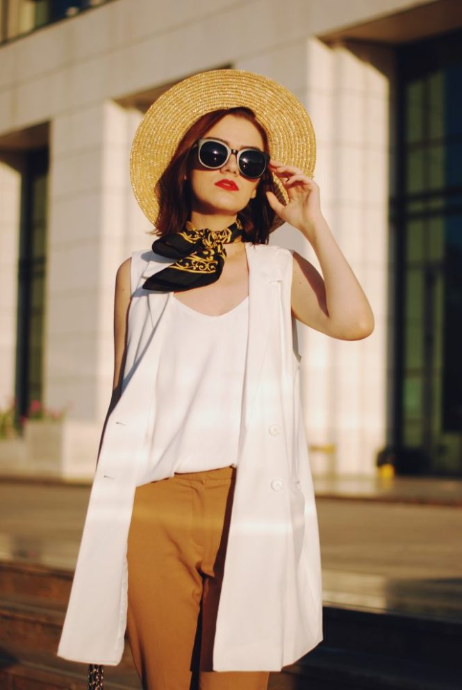 Camel trousers, white camisole top. white vest, gold metallic mules trend, straw hat, silky neck scarf, black crossbody bag, black sunglasses, cute chic summer outfit, Andreea Birsan