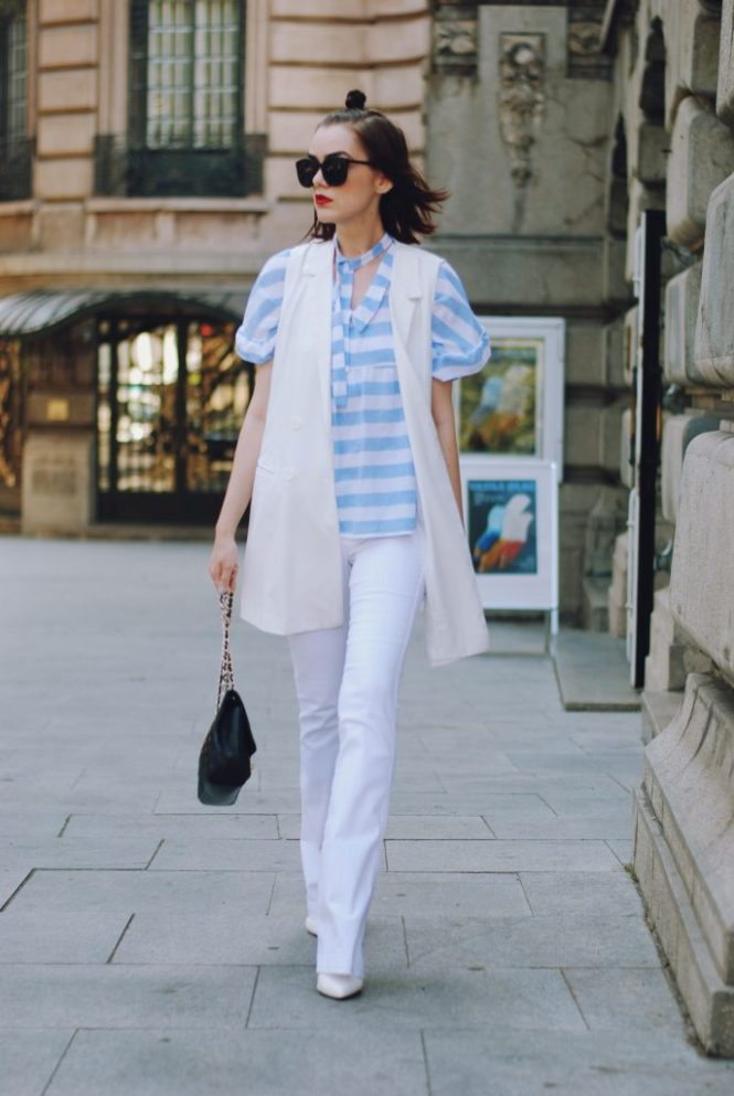 White flared jeans, white waistcoat vest, black sunglasses, striped ruffle top blouse, white stilettos, black crossbody bag, cute summer outfit, Andreea Birsan