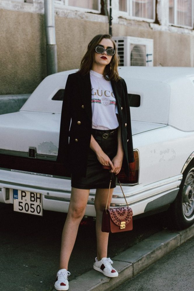 Gucci t-shirt, mango mini skirt, zara blazer, furla ruby red leather lace metropolis shoulder bag, gucci ace heart embroidered sneakers, asos sunglasses, andreea birsan, couturezilla, transitional cute summer outfit ideas 2017, transitional dressing, transitional outfit, gucci logo tee for women, zara a line black leather mini skirt, statement sneakers with hearts, white leather sneakers, choker necklace with stars, gold accessories, square 90s sunglasses, vintage looking sunglasses, double breasted golden buttons black tailored blazer, transitional blazer, the popular gucci t-shirt from instagram, the best blazer for autumn, fall dressing, fall outfit, back to school ootd, too cool for school, statement earrings with thunderbolt, h&m earrings, red lipstick, ombre medium length hair, how to wear a mini skirt and not look like a teenager, mini skirt, black leather mini skirt, tube skirt, mvn blazer, the cute gucci sneakers, how to look Parisian chic, European summer street style inspiration for women 2017, pinterest chic outfit ideas for woman, summer outfit ideas, summer ootd inspiration, outfit of the day, ootd, fashion icon, style inspiration, fashionista, fashion inspiration, style inspo, what to wear in summer, how to look French, chic on a budget, zara outfit, mango, topshop, asos, river island, forever 21, urban outfitters, how to mix high end pieces with luxury ones, zara and Gucci, how to look chic when not wearing a dress, outfit alternatives for summer, tomboy chic, minimal outfit, tumblr girls photos, pictures, happy girl, women, smart casual outfits, the best outfit ideas 2017, what to wear when you don't feel inspired, summer in Europe, weekend attire, uniform, French women in summer, European outfit ideas 2017, minimal chic outfit, how to stand out, the best outfit ideas for summer, the sunglasses you have seen everywhere on Instagram, glasses, uk fashion blogger, united kingdom, uk fashion blog, fashion and travel blog, Europe, women with style, stree