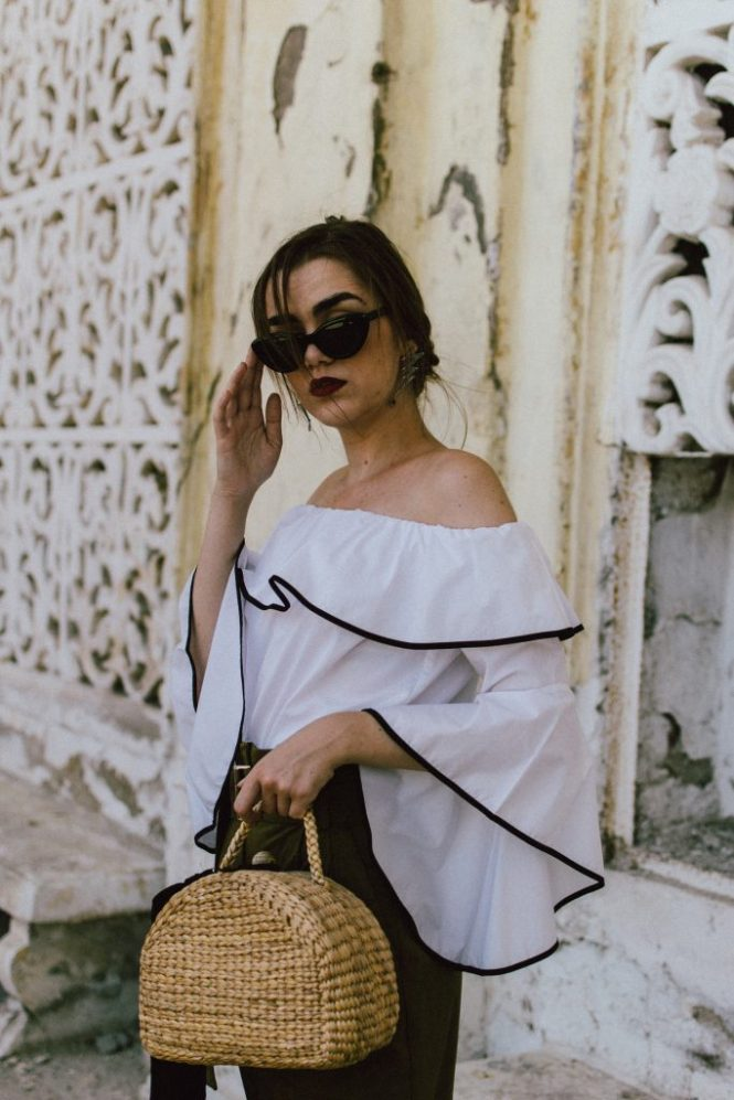 Zara constrast off the shoulder top, high waisted kahki trousers, white leather pumps, straw picnic bag, cat eye sunglasses, andreea birsan, couturezilla, cute summer outfit inspiration 2017, mango contrast off the shoulder top, contrast off shoulder top, OTS top, khaki high waisted trousers, khaki peg high waisted trousers, high waisted paper bag trousers with belt. khaki pants, how to wear high waisted trousers with an OTS top, what to wear with high waisted trousers this summer, what other color to wear instead of black, white court heels, white leaher meed heel pumps, white shoes, statement heels, picnic bag, woven bag, basket bag, raffia bag, the best bag style for summer, bkack skinny scarf, how to accessorize a bag, statement earrings, red lipstick, low bun, cat eye shades, black cat eye sunglasses, sunnies, retro inspired cat eye sunnies, the best sunnies from instagram, popular sunglasses, how to wear a basket bag this summer, parcul bazilescu bucharest, editorial, how to look Parisian chic, European summer street style inspiration for women 2017, pinterest chic outfit ideas for woman, summer outfit ideas, summer ootd inspiration, outfit of the day, ootd, fashion icon, style inspiration, fashionista, fashion inspiration, style inspo, what to wear in summer, how to look French, chic on a budget, zara outfit, mango, topshop, asos, river island, forever 21, urban outfitters, how to mix high end pieces with luxury ones, zara and Gucci, how to look chic when not wearing a dress, outfit alternatives for summer, tomboy chic, minimal outfit, tumblr girls photos, pictures, happy girl, women, smart casual outfits, the best outfit ideas 2017, what to wear when you don't feel inspired, summer in Europe, weekend attire, uniform, French women in summer, European outfit ideas 2017, minimal chic outfit, how to stand out, the best outfit ideas for summer, the sunglasses you have seen everywhere on Instagram, glasses, uk fashion blogger, united kingdom, uk fashion blog, fashion and travel blog, Europe, women with style, street style, summer fashion trends 2017, best fashion ideas, styling, high waisted trousers