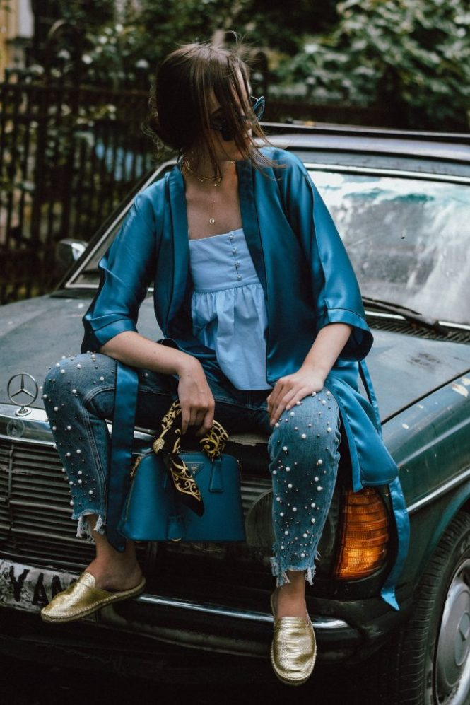Zara pearl embellished mom jeans, asos step hem mom jeans, the pearl trend, pearls on jeans, mom jeans, asymmetric hem jeans, the mom jeans of your dreams, how to look Parisian chic, European summer street style inspiration for women 2017, pinterest chic outfit ideas for woman, summer outfit ideas, summer ootd inspiration, outfit of the day, ootd, fashion icon, style inspiration, fashionista, fashion inspiration, style inspo, what to wear in summer, how to look French, chic on a budget, zara outfit, mango, topshop, asos, river island, forever 21, urban outfitters, how to mix high end pieces with luxury ones, zara and Gucci, how to look chic when not wearing a dress, outfit alternatives for summer, tomboy chic, minimal outfit, tumblr girls photos, pictures, happy girl, women, smart casual outfits, the best outfit ideas 2017, what to wear when you don't feel inspired, summer in Europe, weekend attire, uniform, French women in summer, European outfit ideas 2017, minimal chic outfit, how to stand out, the best outfit ideas for summer, the sunglasses you have seen everywhere on Instagram, glasses, uk fashion blogger, united kingdom, uk fashion blog, fashion and travel blog, Europe, women with style, street style, summer fashion trends 2017, best fashion ideas, styling, the popular pearl jeans from instagram, topshop baby doll blue ruffle top, frilled cami, summer top, baby blue ruffle top, the perfect top for summer, adjustable straps top, baby blue, blue summer top, frills, ruffle trend 2017, aldo gold metallic flat mules, silk blue kimono, cloroom blue mulberry silk kimono, royal blue kimono, silky, luxe meets fast fashion, high end, blue prada bag, prada mini bag, saffiano lux borsa a mano cobalt blue prada bag, scratch free bag, prada bag, cobalt blue prada bag, silk scarf, vintage scarf, vintage mercedes benz car, vintage emerald benz, emerald vintage car, dolce and gabanna square blue sunglasses, square sunglasses, blue sunglasses, sunnies, jewellry, statement accessories, statement earrings, banana leaf earrings, leaf eaarings, gold accessories, how to layer chocker necklaces, layered choker necklaces, how to layer choker necklaces, star choker necklace, how to wear a kimono like a pro, what to wear with a kimono, the best kimono for summer zara, the zara sold out kimono, hand embroidered, embellishements, what to wear with pearl jeans, andreea birsan, couturezilla, cute summer outfit 2017, Zara pearl embellished mom jeans, ruffle top, gold metallic mules, silk blue kimono, prada bag, andreea birsan, couturezilla, cute summer outfit 2017, summer street style