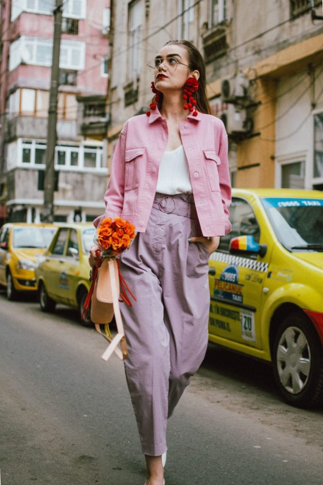 Pastels, pink denim jacket, purple trousers, white shoes, statement earrings, andreea birsan, couturezilla, cute spring outfit ideas 2018, pink and purple spring outfit ideas for 2018, pink cropped cotton jacket, pink trucker jacket, cropped pink denim jacket from na-kd, nakd jacket, mango white camisole top, cami tank top, basic white cami, how to wear a white cami top, how to wear pastels this spring, the pastels fashion trend, head to toe pastels, statement bag, multicolor bag, mini bag, micro tote bag, dusty pink bag, blush pink bag, red statement earrings, earrings with pom poms, xxl earrings, aviator clear lens glasses, the instagram clear lens glasses trend, purple high waisted peg trousers, the best mango trousers, linen and cotton, white leather pumps with block heel, white leather shoes, the white shoes trend, liliac, violet trousers, liliac pants, pastel pants, peg trousers, high waisted trousers with belt detail, how to look Parisian chic, European summer street style inspiration for women 2017, pinterest chic outfit ideas for woman, summer outfit ideas, summer ootd inspiration, outfit of the day, ootd, fashion icon, style inspiration, fashionista, fashion inspiration, style inspo, what to wear in summer, how to look French, chic on a budget, zara outfit, mango, topshop, asos, river island, forever 21, urban outfitters, how to mix high end pieces with luxury ones, zara and Gucci,outfit alternatives for summer, tomboy chic, minimal outfit, tumblr girls photos, pictures, happy girl, women, smart casual outfits, the best outfit ideas 2017, what to wear when you don't feel inspired, summer in Europe, weekend attire, uniform, French women in summer, European outfit ideas 2017, minimal chic outfit, how to stand out, the best outfit ideas for summer, the sunglasses you have seen everywhere on Instagram, glasses, uk fashion blogger, united kingdom, uk fashion blog, fashion and travel blog, Europe, women with style, street style, summer fashion trends 2017, best fashion ideas, styling, fall fashion, fall outfit, fall ootd, fall perfect, transitional dressing, best transitional outfit ideas, how to wear statement earrings, dressing for autumn, autumn outfit, winter outfit ideas for work and school 2017