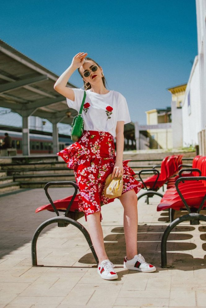 NA-KD asymmetric floral print skirt, rose patch t-shirt, gucci heart sneakers, prada green bag, andreea birsan, couturezilla, cute spring outfit ideas 2018, cherry blossom skirt, midi skirt with double frills, red midi skirt with double frill and floral print, sakura print midi skirt, feminine skirt, how to temper a feminine look, rose patch white t-shirt from nakd, the popular rose boobs t-shirt, how to mix floral prints, gucci ace heart embroidered white sneakers, red midi skirt, red and white outfit, gucci sneakers, gucci leather sneakers, white trainers, how to wear a skirt with sneakers, green prada bag with studs and stones, green shoulder bag, h&m oval sunglasses, oval sunglasses, micro sunglasses trend, how to wear a midi skirt, what shoes to wear with a midi skirt, how to wear an asymmetric skirt, asymmetrical skirt, sakura, floral print midi skirt, flower print, red, red skirt, what color to wear with red, red and green, gold hoop earrings, skirt and sneakers, how to look Parisian chic, European summer street style inspiration for women 2017, pinterest chic outfit ideas for woman, summer outfit ideas, summer ootd inspiration, outfit of the day, ootd, fashion icon, style inspiration, fashionista, fashion inspiration, style inspo, what to wear in summer, how to look French, chic on a budget, zara outfit, mango, topshop, asos, river island, forever 21, urban outfitters, how to mix high end pieces with luxury ones, zara and Gucci,outfit alternatives for summer, tomboy chic, minimal outfit, tumblr girls photos, pictures, happy girl, women, smart casual outfits, the best outfit ideas 2017, what to wear when you don't feel inspired, summer in Europe, weekend attire, uniform, French women in summer, European outfit ideas 2017, minimal chic outfit, how to stand out, the best outfit ideas for summer, the sunglasses you have seen everywhere on Instagram, glasses, uk fashion blogger, united kingdom, uk fashion blog, fashion and travel blog, Europe, women with style, s