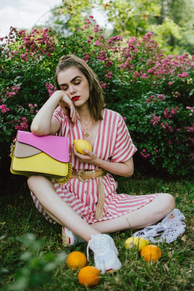 Striped midi dress, chunky white sneakers, statement colorblock shoulder bag, rose garden, coin necklace, andreea birsan, couturezilla, cute summer outfit ideas 2018, coin necklace, mango midi striped linen dress, linen dress, striped midi dress and sneakers, chunky trainers, chunky sneakers, dad sneakers trend, the ugly sneakers trend, white trainers, trainers and feminine dress, retro dress and chunky trainers, gold plated coin necklace, onecklace jewelry, isla fontaine statement shoulder bag, pink and yellow bag, the best bags from isla fontaine, mini bun hairstyle, gold metallic belt, rose garden, the necklace you need to wear this summer, red and white midi dress, crisp white sneakers, balenciaga inspired triple s sneakers, balenciaga dupe sneakers, where to find the budget alternative to the balenciaga triple s sneakers, balenciaga sneakers, trending, summer trends of 2018, how to look Parisian chic, European summer street style inspiration for women 2017, pinterest chic outfit ideas for woman, summer outfit ideas, summer ootd inspiration, outfit of the day, ootd, fashion icon, style inspiration, fashionista, fashion inspiration, style inspo, what to wear in summer, how to look French, chic on a budget, zara outfit, mango, topshop, asos, river island, forever 21, urban outfitters, how to mix high end pieces with luxury ones, zara and Gucci,outfit alternatives for summer, tomboy chic, minimal outfit, tumblr girls photos, pictures, happy girl, women, smart casual outfits, the best outfit ideas 2017, what to wear when you don't feel inspired, summer in Europe, weekend attire, uniform, French women in summer, European outfit ideas 2017, minimal chic outfit, how to stand out, the best outfit ideas for summer, the sunglasses you have seen everywhere on Instagram, glasses, uk fashion blogger, united kingdom, uk fashion blog, fashion and travel blog, Europe, women with style, street style, summer fashion trends 2017, best fashion ideas, styling, fall fashion, fall out