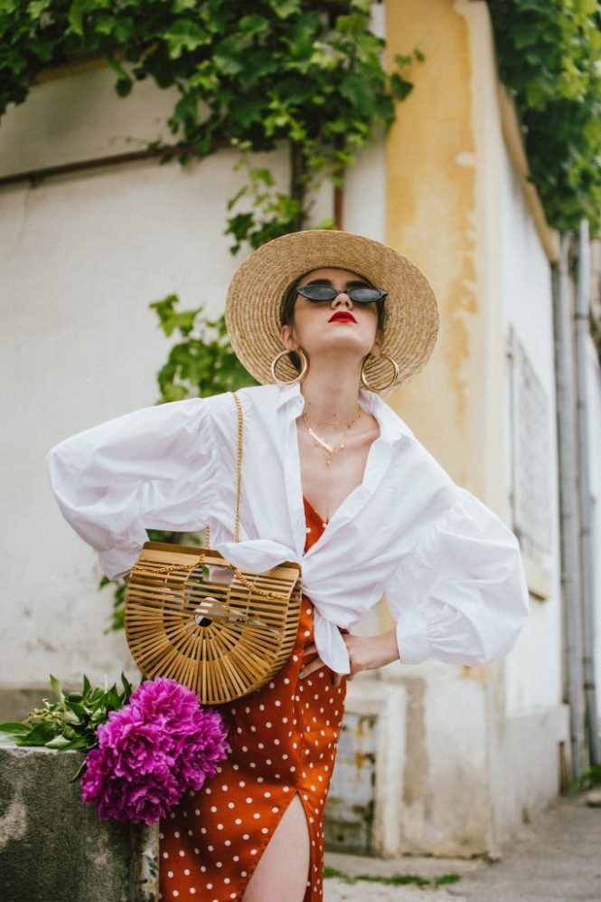 Summer bags 2018, andreea birsan summer bags edit, straw bags, wicker bags, raffia bags, pom pom, couturezilla, cult gaia ark bag, bag inspo 2018, bag trends, natural bags, hand made bags, the best summer bags of 2018, how to style beach bags in the city, the easy way to wear straw bags, the best straw bags around, asos, topshop, sea and grass, boho peach, cult gaia inspired bags, cult gaia ark bag, where to find the best summer bags of 2018, 2018 fresh casual ideas, american style, andreea birsan street styles, asos, casual off duty style, couturezilla, cute and casual outfits for spring 2018, european fashion blogger, fashion inspiration, fashion inspo, fashionista, how to dress like a parisian, how to look parisian chic, how to make minimal outfits stand out, mango, minimal outfits for spring, modern minimalism, ootd, outfit of the day, pinterest outfit for women, red cat eye sunglasses, red lipstick, romanian fashion blog, romanian fashion blogger, silk scarf, spring fashion trends for 2018, spring outfit inspiration 2018, spring outfits for women, spring street style 2018, topshop, tumblr girls outfit, women with style, zara, uk blogger, fall dressing, transitional outfits, autumn ootd, autumn outfit, fall fashion, winter outfit ideas 2018, cute winter ootd, winter outfit ideas for work and school, street style 2018, balloon sleeve white shirt, tied shirt, shirt over dress, polka dot rusty midi dress, polka dot dress with spaghetti straps, polka dot dress, gold layered necklaces, name necklace, cult gaia ark bamboo bag, peonies, big gold hoop earrings, small cat eye sunglasses, the micro sunglasses trend, straw boater hat
