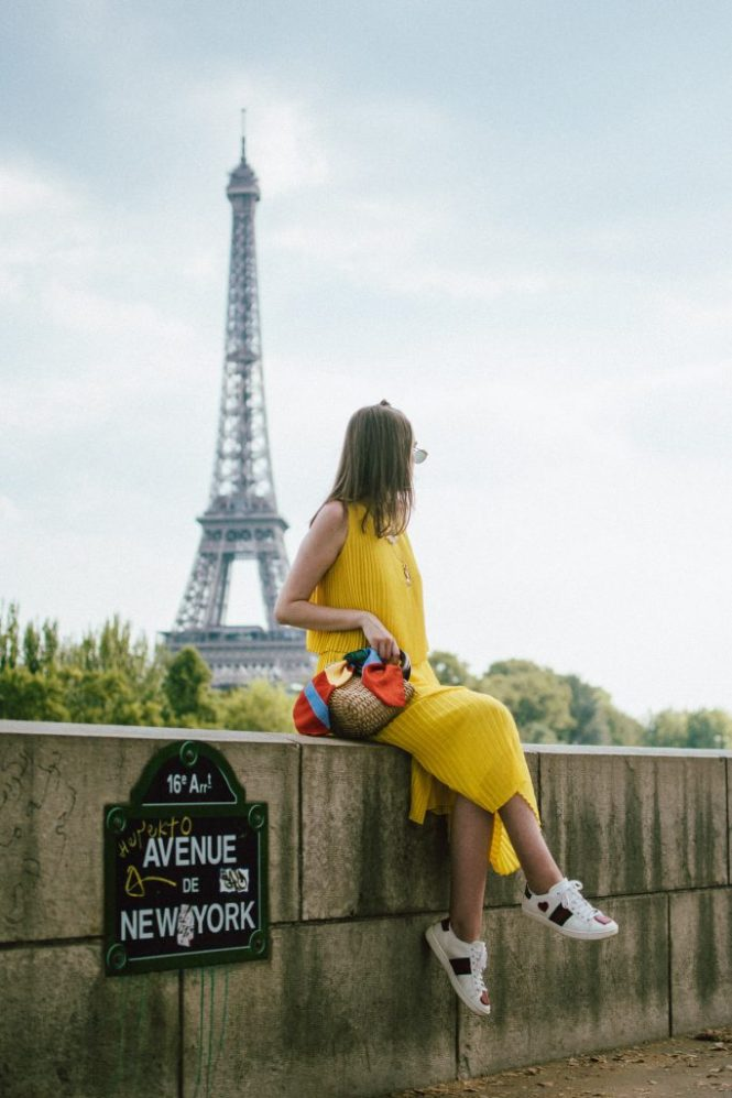 Massimo Dutti pleated yellow dress, gucci ace heart sneakers, paris, andreea birsan, couturezilla, cute summer outfit ideas for 2018, midi yellow dress, what to wear as a wedding guest, summer wedding guest dress, versatile wedding guest dresses, pleated dress, how to wear a midi dress, how to wear pleated dresses, dressed in dutti, massimo dutti dresses, yellow massimo dutti dress, dress and sneakers, gucci ace heart embroidered white leather sneakers, gucci trainers, the best gucci sneakers, shoes to invest in, should worth investing in, the best gucci sneakers, gucci kicks, white leather sneakers, durable sneakers, micro oval sunglasses, ray ban inspired sunglasses, straw bag, the best summer bags, mini bags, wood handle bag, striped scarf, tourist in paris, paris for a day, silk scarf, shell necklaces, gold layered necklaces, yellow dress to wear this summer, how to wear a dress with sneakers, sporty and chic outfit, half bun, wood handle handmade bag, the best summer bags, boho peach bag, eiffel tower photos, blogger photos from paris, the best views in paris, how to get a photo with the eiffel tower in the background, best photo spots in paris, instagram worthy spots in paris, france, travel blogger, european summer, summer vacation in paris, best instagram spots in paris, how to look Parisian chic, European summer street style inspiration for women 2017, pinterest chic outfit ideas for woman, summer outfit ideas, summer ootd inspiration, outfit of the day, ootd, fashion icon, style inspiration, fashionista, fashion inspiration, style inspo, what to wear in summer, how to look French, chic on a budget, zara outfit, mango, topshop, asos, river island, forever 21, urban outfitters, how to mix high end pieces with luxury ones, zara and Gucci,outfit alternatives for summer, tomboy chic, minimal outfit, tumblr girls photos, pictures, happy girl, women, smart casual outfits, the best outfit ideas 2017, what to wear when you don't feel inspired, summer in Europe, weekend attire, uniform, French women in summer, European outfit ideas 2017, minimal chic outfit, how to stand out, the best outfit ideas for summer, the sunglasses you have seen everywhere on Instagram, glasses, uk fashion blogger, united kingdom, uk fashion blog, fashion and travel blog, Europe, women with style, street style, summer fashion trends 2017, best fashion ideas, styling, fall fashion, fall outfit, fall ootd, fall perfect, transitional dressing, best transitional outfit ideas, how to wear statement earrings, dressing for autumn, autumn outfit, winter outfit ideas for work and school 2017