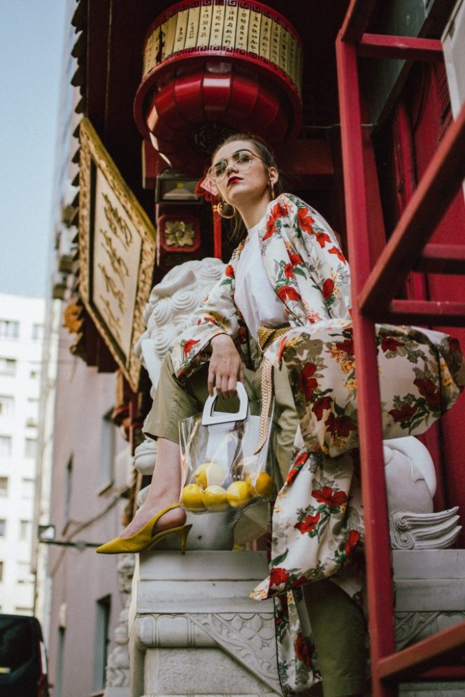 Boohoo longline floral kimono, khaki peg trousers, white t-shirt, transparent bag, yellow slingback shoes, andreea birsan, couturezilla, cute fall outfit ideas 2018, beige satin floral kimono, what to wear with a kimono, how to wear a floral kimono in autumn, autumn outfit, how to transition from summer to autumn, mango oversized boyfriend white t-shirt, white tee, khaki trousers, khaki wide leg trousers, how to wear peg trousers without looking bulky, china town editorial, yellow suede kitten heel slingback shoes, yellow slingbacks, yellow high heel shoes, how to wear yellow shoes, what color goes with yellow, yellow khaki and white outfit, the pvc bag trend, how to pull off the transparent bag trend, clear tote bag, staud inspired clear bag, the plastic bag trend, clear lens aviator glasses, how to pull off the geeky glasses trend, clear lens glasses, gold hoop earrings, gold metallic vintage belt, how to wear a gold belt, floral kimono, long kimono, baggy trousers trend, khaki pants, khaki pants, wide pants, lemons, how to look Parisian chic, European summer street style inspiration for women 2017, pinterest chic outfit ideas for woman, summer outfit ideas, summer ootd inspiration, outfit of the day, ootd, fashion icon, style inspiration, fashionista, fashion inspiration, style inspo, what to wear in summer, how to look French, chic on a budget, zara outfit, mango, topshop, asos, river island, forever 21, urban outfitters, how to mix high end pieces with luxury ones, zara and Gucci,outfit alternatives for summer, tomboy chic, minimal outfit, tumblr girls photos, pictures, happy girl, women, smart casual outfits, the best outfit ideas 2017, what to wear when you don't feel inspired, summer in Europe, weekend attire, uniform, French women in summer, European outfit ideas 2017, minimal chic outfit, how to stand out, the best outfit ideas for summer, the sunglasses you have seen everywhere on Instagram, glasses, uk fashion blogger, united kingdom, uk fashion blog, fashion and travel blog, Europe, women with style, street style, summer fashion trends 2017, best fashion ideas, styling, fall fashion, fall outfit, fall ootd, fall perfect, transitional dressing, best transitional outfit ideas, how to wear statement earrings, dressing for autumn, autumn outfit, winter outfit ideas for work and school 2017