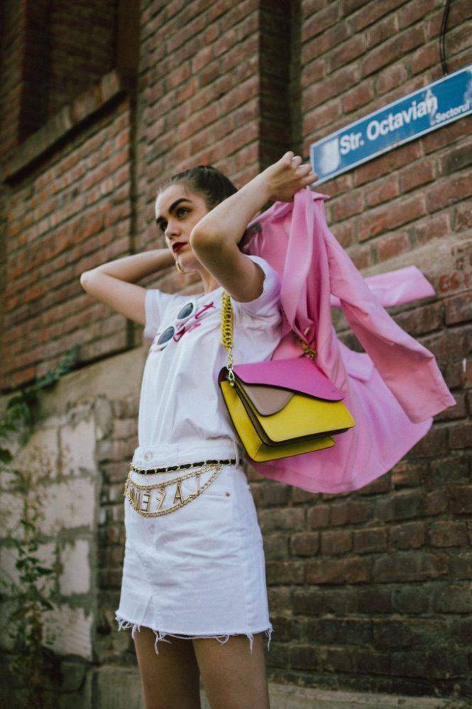 Pink blazer, white denim skirt, white tee, gucci sneakers, colorblock shoulder bag, andreea birsan, couturezilla, cute fall outfit ideas 2018, la femme gold chain belt, the chain belt trend, white cat eye sunglasses, cat eye sunnies, autumn outfit ideas, transitional outfits, pre-fall white and pink outfit 2018, what color to wear with pink, pink and white looks, how to transition your wardrobe to autumn, white mini raw hem denim skirt, deconstructed mini skirt, crisp white mango premium white denim skirt, what to wear with a mini skirt, what are the best shoes to wear with a mini skirt, gucci white and red sneakers, gucci white leather trainers, white gucci kicks, the ugly dad sneakers trend, gucci dad sneakers, bowling shoes trend, chunky trainers trend, chunky sneakers trend, white sunnies, heart breaker white t-shirt, white skirt and t-shirt, organic cotton tee, embroidered t-shirt, mini skirt, how to wear a mini skirt without looking vulgar, gucci shoes, isla fontaine pink and yellow leather bag, italian leather shoulder bag, italian bag, gold hoop earrings, hoop earrings, white and pink pre-fall 2018 outfit ideas for women, how to look Parisian chic, European summer street style inspiration for women 2017, pinterest chic outfit ideas for woman, summer outfit ideas, summer ootd inspiration, outfit of the day, ootd, fashion icon, style inspiration, fashionista, fashion inspiration, style inspo, what to wear in summer, how to look French, chic on a budget, zara outfit, mango, topshop, asos, river island, forever 21, urban outfitters, how to mix high end pieces with luxury ones, zara and Gucci,outfit alternatives for summer, tomboy chic, minimal outfit, tumblr girls photos, pictures, happy girl, women, smart casual outfits, the best outfit ideas 2017, what to wear when you don't feel inspired, summer in Europe, weekend attire, uniform, French women in summer, European outfit ideas 2017, minimal chic outfit, how to stand out, the best outfit ideas for summer, the s
