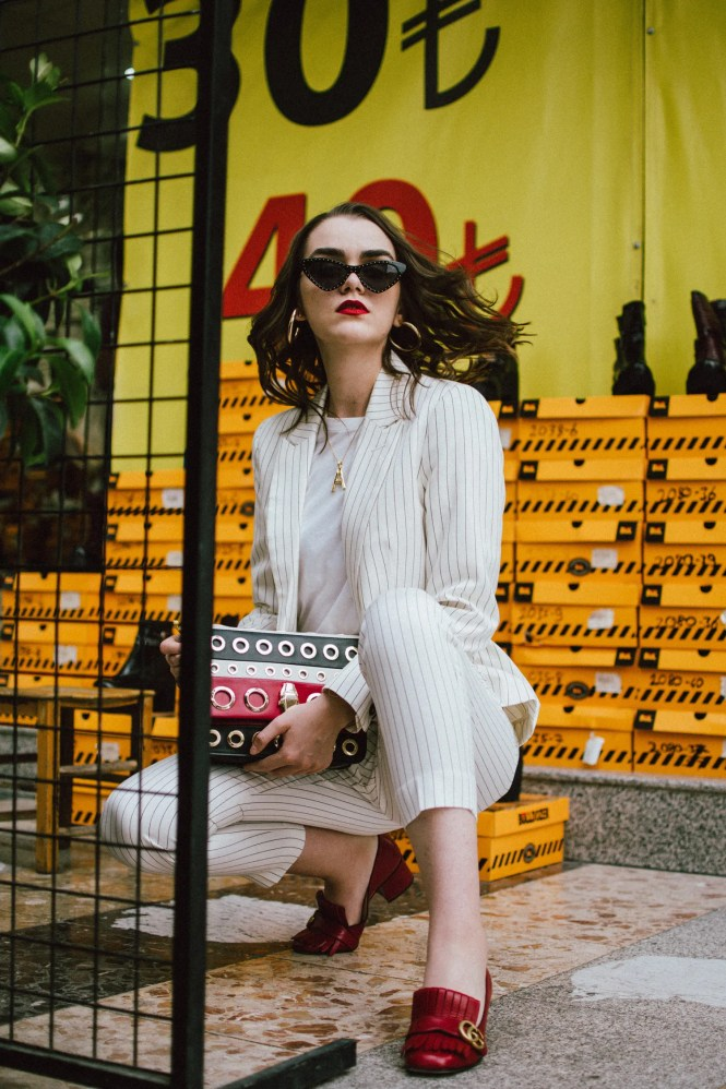 Mango stripe suit, red gucci shoes, A necklace, cat eye sunglasses, cavalli shoulder bag, andreea birsan in izmir turkey, couturezilla, cute fall outfit ideas 2018, womens pinstripe suit, power suit for women, striped suit, stripe trousers, stripe blazer, blazers with stripes, how to wear stripes, basic white t-shirt, boyfriend white tee, organic cotton white tee, embellished black cat eye sunglasses, just cavalli genuine leather shoulder bag with stripes and eyelets, statement bag, how to wear a statement bag, wedding guest outfit idea for those who don't want to wear a dress, red gucci marmont pumps, red gucci heels, red leather shoes, dark white, celine inspired initial necklace, gold accessories, gold necklace, moschino inspired black pointy cat eye sunglasses, red white and black crossbody bag, yellow bag strap, how to rock a suit in fall 2018, how to look Parisian chic, European summer street style inspiration for women 2017, pinterest chic outfit ideas for woman, summer outfit ideas, summer ootd inspiration, outfit of the day, ootd, fashion icon, style inspiration, fashionista, fashion inspiration, style inspo, what to wear in summer, how to look French, chic on a budget, zara outfit, mango, topshop, asos, river island, forever 21, urban outfitters, how to mix high end pieces with luxury ones, zara and Gucci,outfit alternatives for summer, tomboy chic, minimal outfit, tumblr girls photos, pictures, happy girl, women, smart casual outfits, the best outfit ideas 2017, what to wear when you don't feel inspired, summer in Europe, weekend attire, uniform, French women in summer, European outfit ideas 2017, minimal chic outfit, how to stand out, the best outfit ideas for summer, the sunglasses you have seen everywhere on Instagram, glasses, uk fashion blogger, united kingdom, uk fashion blog, fashion and travel blog, Europe, women with style, street style, summer fashion trends 2017, best fashion ideas, styling, fall fashion, fall outfit, fall ootd, fall perfect, t