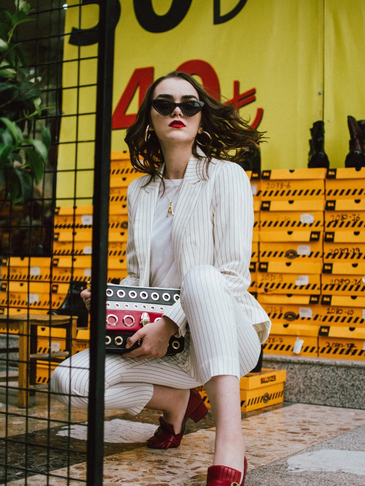 Mango stripe suit, red gucci shoes, A necklace, cat eye sunglasses, cavalli shoulder bag, andreea birsan in izmir turkey, couturezilla, cute fall outfit ideas 2018, womens pinstripe suit, power suit for women, striped suit, stripe trousers, stripe blazer, blazers with stripes, how to wear stripes, basic white t-shirt, boyfriend white tee, organic cotton white tee, embellished black cat eye sunglasses, just cavalli genuine leather shoulder bag with stripes and eyelets, statement bag, how to wear a statement bag, wedding guest outfit idea for those who don't want to wear a dress, red gucci marmont pumps, red gucci heels, red leather shoes, dark white, celine inspired initial necklace, gold accessories, gold necklace, moschino inspired black pointy cat eye sunglasses, red white and black crossbody bag, yellow bag strap, how to rock a suit in fall 2018, how to look Parisian chic, European summer street style inspiration for women 2017, pinterest chic outfit ideas for woman, summer outfit ideas, summer ootd inspiration, outfit of the day, ootd, fashion icon, style inspiration, fashionista, fashion inspiration, style inspo, what to wear in summer, how to look French, chic on a budget, zara outfit, mango, topshop, asos, river island, forever 21, urban outfitters, how to mix high end pieces with luxury ones, zara and Gucci,outfit alternatives for summer, tomboy chic, minimal outfit, tumblr girls photos, pictures, happy girl, women, smart casual outfits, the best outfit ideas 2017, what to wear when you don't feel inspired, summer in Europe, weekend attire, uniform, French women in summer, European outfit ideas 2017, minimal chic outfit, how to stand out, the best outfit ideas for summer, the sunglasses you have seen everywhere on Instagram, glasses, uk fashion blogger, united kingdom, uk fashion blog, fashion and travel blog, Europe, women with style, street style, summer fashion trends 2017, best fashion ideas, styling, fall fashion, fall outfit, fall ootd, fall perfect, transitional dressing, best transitional outfit ideas, how to wear statement earrings, dressing for autumn, autumn outfit, winter outfit ideas for work and school 2017
