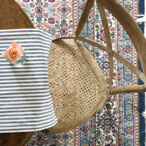 antique rug, cane dining chair, stripes