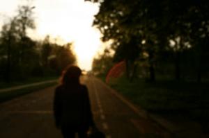 Woman walking down a road