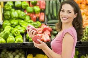 Woman Choosing Vegetables From Shop