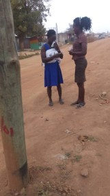 Sister Della witnessing to a woman on the road