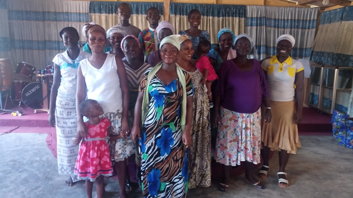 People of Christian Forces Church gather to receive clothing donated by Hephzibah