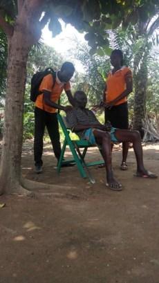 Praying over an elderly man