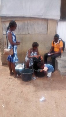 Team witnessing to a woman washing dishes