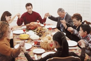 Family Celebrates Thanksgiving Pray Praise God