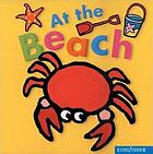At the Beach. Cover has a crab, pail, shovel, and starfish.