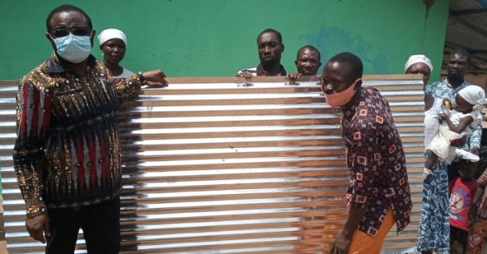 Wisdom Kobena Mensah Woyome doing the donation