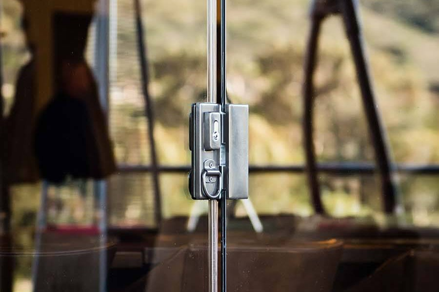 Zoomed in detail of a sliding glass panel's locking system.
