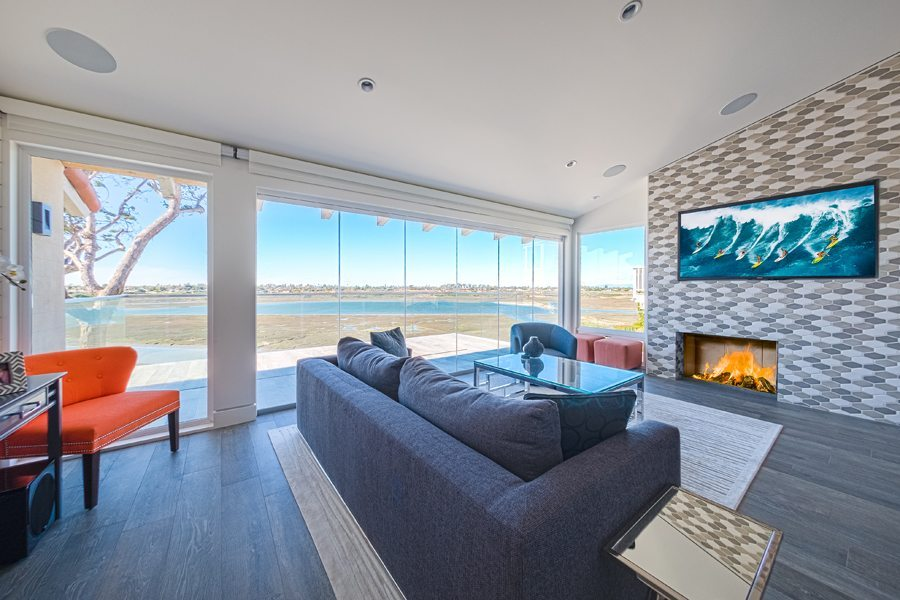Living room with enclosed frameless sliding glass doors.