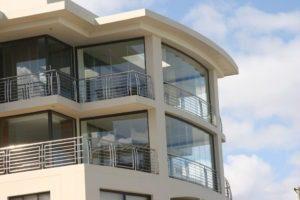 Apartment complex with frameless sliding glass doors.