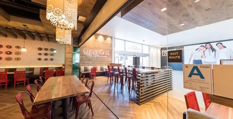 Framless glass doors inside Luna Grill restaurant