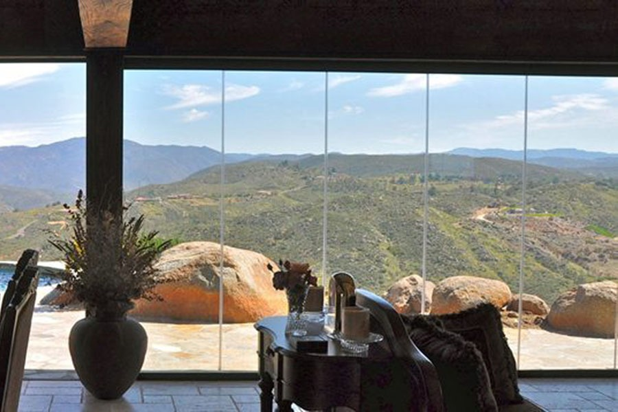 Looking at view with enclosed frameless sliding glass doors.
