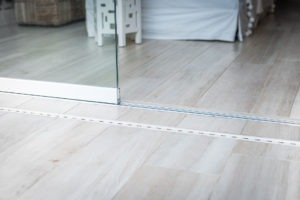 Track of frameless sliding glass doors.