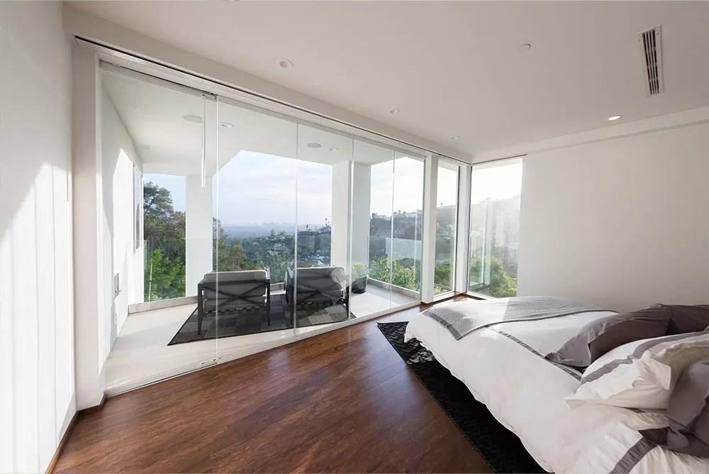 Looking outside bedroom frameless glass doors