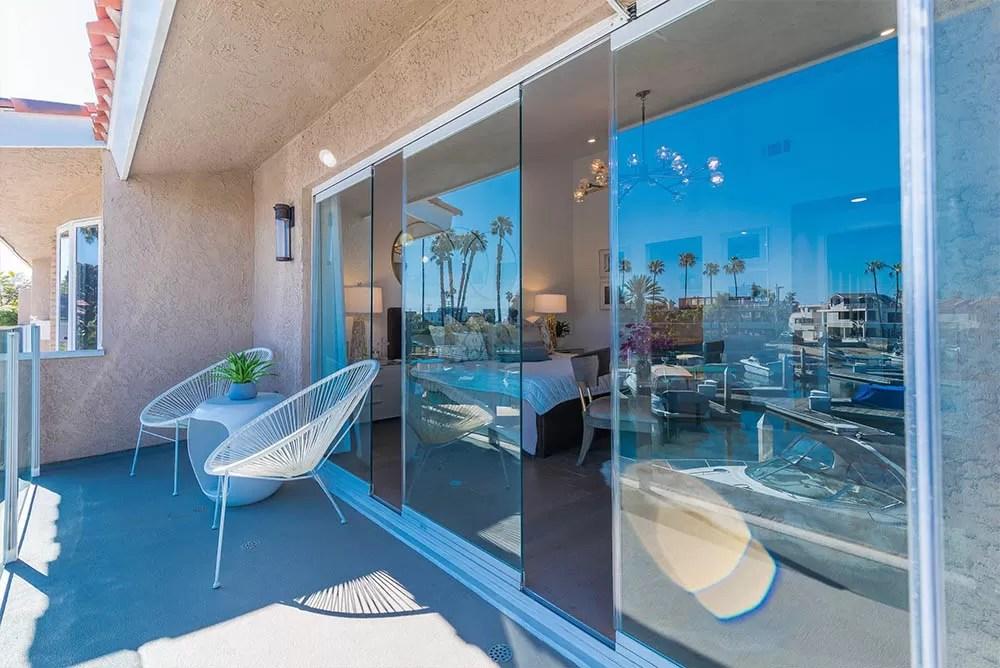 Patio with three frameless glass doors slightly open