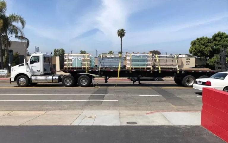 Large truck carrying frameless glass windows