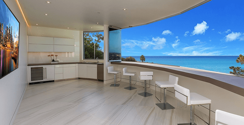 Curved glass walls overlooking the beach.