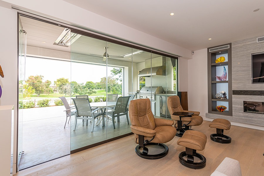 Frameless sliding glass doors enclosed with one panel open.