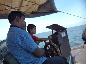 Kiddo enjoying cruising the houseboat