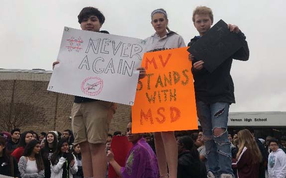 Students holding signs