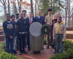 Storck standing with other politicians and boy scouts at Mount Vernon