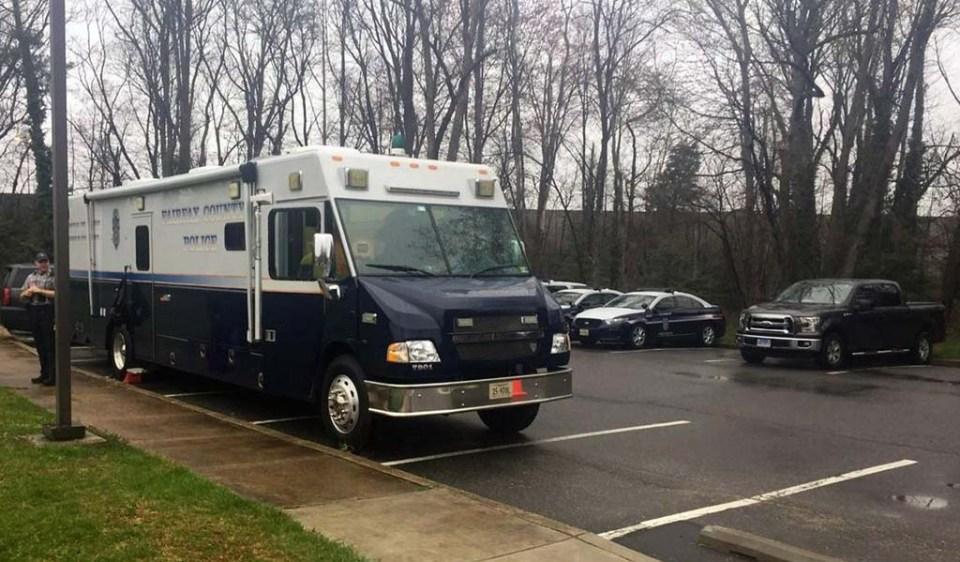 Police van in parking lot