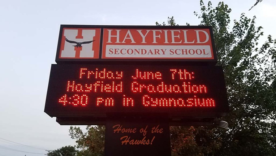 School marquee with graduation information on it