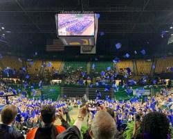 Graduation caps being thrown in air