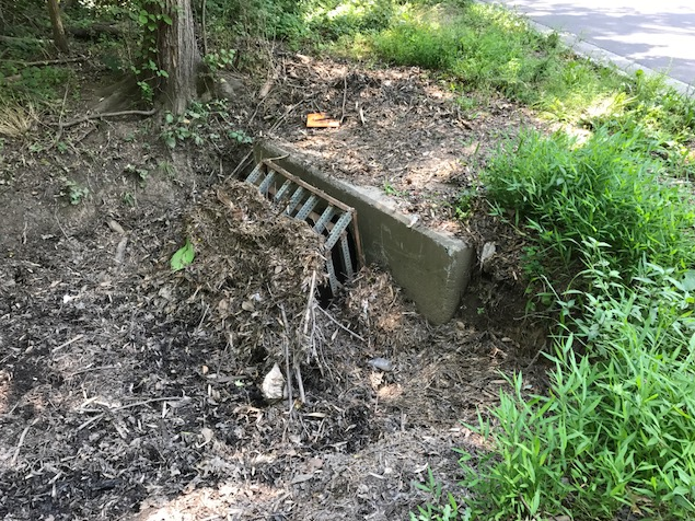 Culvert entrance with dirt blocking it