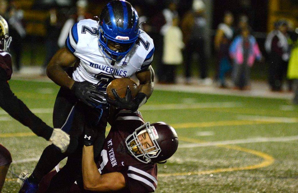 Kobiah running through tackle against Mount Vernon during night game last year