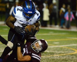 Kobiah running through tackle during night game against Mount Vernon last year