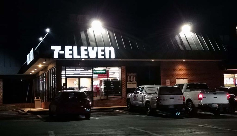 7-Eleven at the corner of North Kings Highway and School Street photographed at night