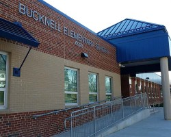 The front of Bucknell Elementary, with letters spelling out name of school visible on bricks next to awning over main entrance