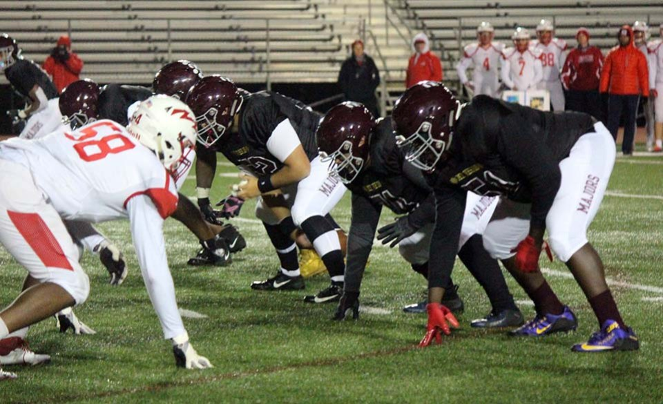 The right side of Mount Vernon's offensive line in their stances against Annandale