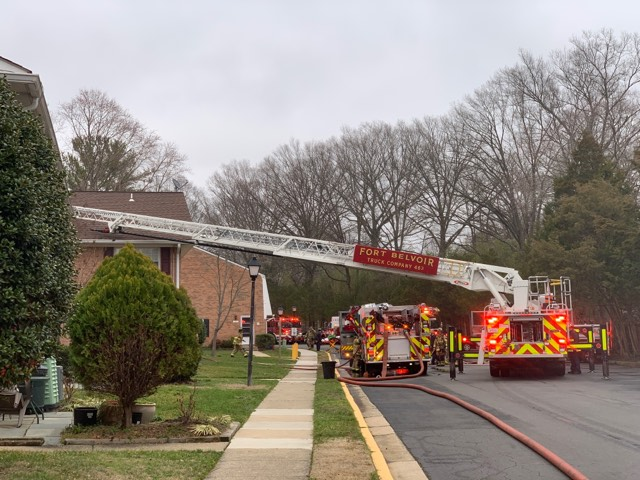 Ladder truck from Fort Belvoir and other fire trucks on the scene of the fire